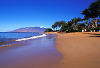Ulua Beach on Maui's South Side is one of Maui's best and most popular beaches. It is a favorite for early morning walks, snorkeling, swimming, sunbathing, scuba and just family fun. The West Maui Mountains can be seen in the background.