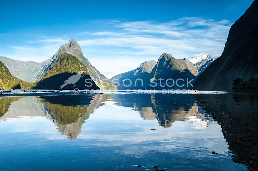 Mitre Peak reflected in calm waters at Milford Sound, Fiordland National Park, South Island, New Zealand - stock photo, canvas, fine art print