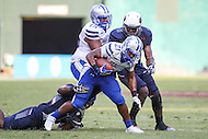 Washington, DC - September 16, 2016: Hampton Pirates running back Eric Carter (21) gets tackled by a Howard Bison defender during game between Hampton and Howard at  RFK Stadium in Washington, DC. September 16, 2016.  (Photo by Elliott Brown/Media Images International)