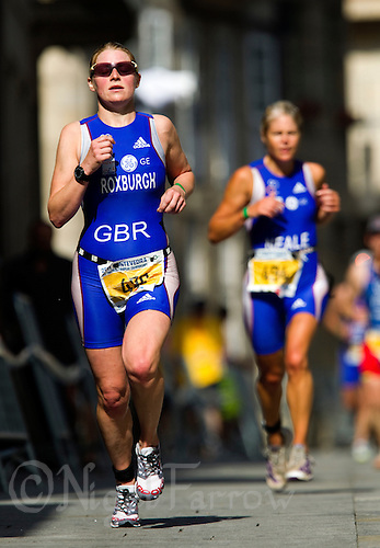 26 JUN 2011 - PONTEVEDRA, ESP - Rhian Roxburgh (GBR), gold medalist in the women's 35-39 category at the European Age Group Olympic Distance Triathlon Championships leads fellow Britain, silver medalist in the same category Tamsin Neale, on the run.(PHOTO (C) NIGEL FARROW)