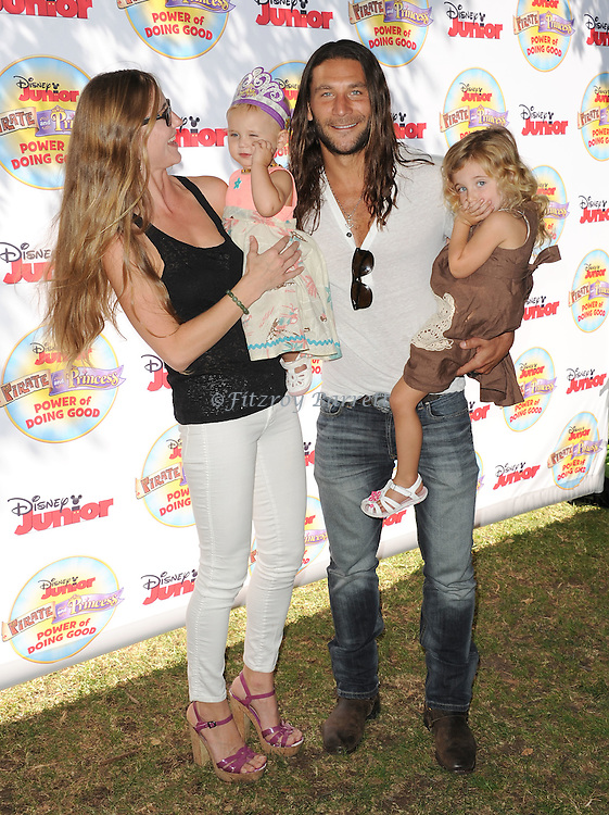 Zach McGowan and family arriving at Pirate and Princess: Power Of Doing Good, held at Brookside Park Pasadena, Ca. on August 16, 2014.