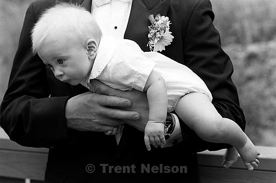 Nathaniel Nelson in Ken Quayle's arms at Ted Hansen and Sarah Pendleton's wedding.<br />