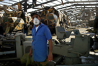 Tripoli, Libya, March 22, 2011.Two large warehouses inside Tripoli's Abu Sitta Naval base were bombed by the coalition. At least five twin Russian made mobile ground to ground rocket launchers as well as several missiles lay in the rubble. This location was used as a maintenance and training workshop, not as an 'active' site. The second warehouse contained a large naval engine maintenance workshop but no visible weapons.