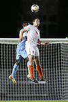 08 October 2013: Clemson's Austen Burnikel (20) and North Carolina's Boyd Okwuonu (behind). The University of North Carolina Tar Heels hosted the Clemson University Tigers at Fetzer Field in Chapel Hill, NC in a 2013 NCAA Division I Men's Soccer match. Clemson won the game 2-1 in overtime.