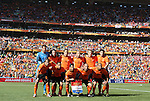 14 JUN 2010: Hollands starters pose for a team photo in a full stadium. The Netherlands National Team defeated the Denmark National Team 2-0 at Soccer City Stadium in Johannesburg, South Africa in a 2010 FIFA World Cup Group E match.
