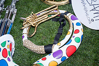 Instruments from the Boston Area Brigade of Activist Musicians (BABAM Band) rest on the ground after they performed on stage in Boston Common as part of the March for Science demonstration on Sat., April 22, 2017.