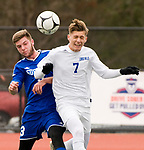 NEW BRITAIN, CT-111817JS10- Lewis Mills' Nick Lutrzykowski (7) heads the ball in front of Suffield's Alek Cotnoir (3) during their Class M state final game Saturday at Willow Brook Park in New Britain.<br /> Jim Shannon Republican-American
