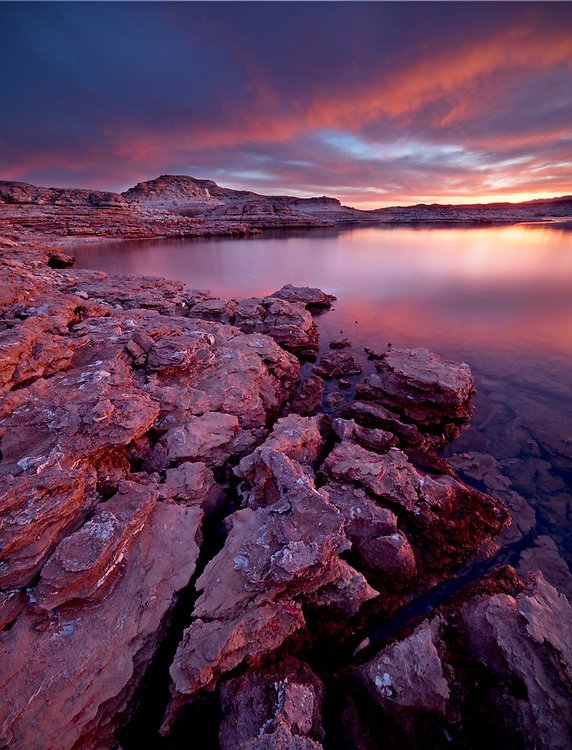 Fiery sunset over the gypsum ledges near East Gypsum Bay in the Virgin Basin in the Lake Mead National Recreation Area on the Arizona-Nevada border, USA