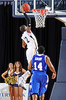 12 January 2012:  FIU guard Jeremy Allen (32) dunks as Middle Tennessee guard Marcos Knight (14) looks on in the first half as the Middle Tennessee State University Blue Raiders defeated the FIU Golden Panthers, 70-59, at the U.S. Century Bank Arena in Miami, Florida.