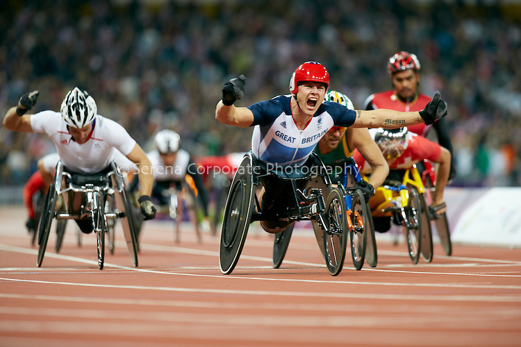 Great Britain's David Weir storms home in the men's T54 5000m final to win gold over his strongest rival Australia's Kurt Fearnley, with France's Julian Casoli taking out the bronze in a close finish..London Paralympic Games Athletics 2.9.12