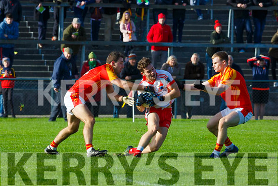 Tomas O'Se An Ghaeltacht is tackled by Matthew Taylor and  Bill Myers Mallow during the Munster Intermediate Championship semi final in Mallow on Sunday
