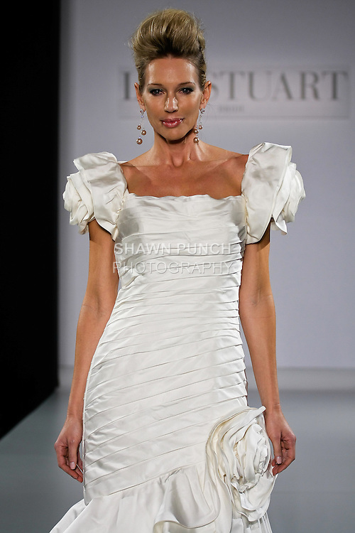 Model walks runway in a Cosmic Queen wedding dress from the Ian Stuart - Supernova Bridal Collection 2013 fashion show, at the Couture Show during New York Bridal Fashion Week, October 14, 2012.