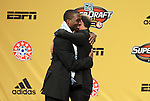 13 January 2011: Sporting Kansas City selected C.J. Sapong (left) with the #10 overall pick. With Commissioner Don Garber (right). The 2011 MLS SuperDraft was held in the Ballroom at Baltimore Convention Center in Baltimore, MD during the NSCAA Annual Convention.