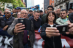 "© Joel Goodman - 07973 332324 . 11/06/2017 . Manchester , UK . People pose for selfies with TOMMY ROBINSON . Demonstration against Islamic hate , organised by former EDL leader Tommy Robinson's "" UK Against Hate "" and opposed by a counter demonstration of anti-fascist groups . UK Against Hate say their silent march from Piccadilly Train Station to a rally in Piccadilly Gardens in central Manchester is in response to a terrorist attack at an Ariana Grande concert in Manchester , and is on the anniversary of the gun massacre at the Pulse nightclub in Orlando . Photo credit : Joel Goodman"