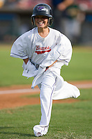 """A young fan competes in the """"Dress like a Dash Player"""" contest between innings at Wake Forest Baseball Stadium August 30, 2009 in Winston-Salem, North Carolina. (Photo by Brian Westerholt / Four Seam Images)"""