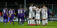 Calcio, Coppa Italia: semifinale di ritorno Fiorentina vs Juventus. Firenze, stadio Artemio Franchi, 7 aprile 2015. <br /> Juventus players, right, celebrate as Fiorentina players leave the pitch at the end of the Italian Cup semifinal second leg football match between Fiorentina and Juventus at Florence's Artemio Franchi stadium, 7 April 2015. Juventus won 3-0 to join the final.<br /> UPDATE IMAGES PRESS/Isabella Bonotto