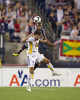 New England Revolution defender Darrius Barnes (25) and Monarcas Morelia forward Miguel Sabah (9) battle for head ball. The New England Revolution defeated Monarcas Morelia in SuperLiga 2010 group stage match, 1-0, at Gillette Stadium on July 20, 2010.