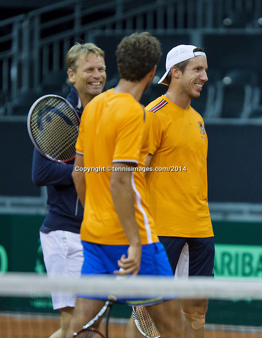 September 08, 2014,Netherlands, Amsterdam, Ziggo Dome, Davis Cup Netherlands-Croatia, Training Dutch Cup Team, Robin Haase in the middle and Igor Sijsling left captain Jan Siemerink<br /> Photo: Tennisimages/Henk Koster
