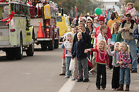 Weather window allows PB Parade to proceed, San Diego California Saturday December 8 2007.  Kids wave to Santa who was perched high up on the Pacific Beach Firestation 21 truck at the tail end of the parade.