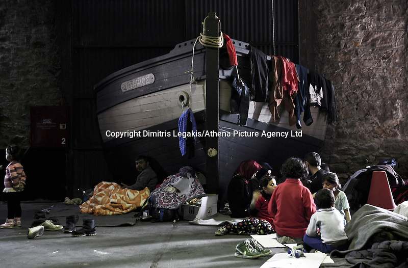 Pictured: Migrants take shelter in a disused warehouse Tuesday 01 March 2016<br /> Re: Migrants at the port of Piraeus, near Athens, Greece