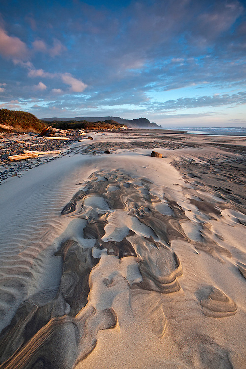 Sculpted sand patterns on the beach at Carl Washburne State Park in Oregon, USA