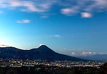 San Salvador, El Salvador at dusk with the San Salvador Volcano and the iconic El Picacho Peak rising above the city.