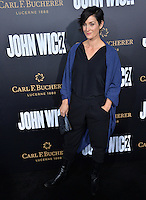 Carrie-Anne Moss at the premiere of &quot;John Wick Chapter Two&quot; at the Arclight Theatre, Hollywood. <br /> Los Angeles, USA 30th January  2017<br /> Picture: Paul Smith/Featureflash/SilverHub 0208 004 5359 sales@silverhubmedia.com