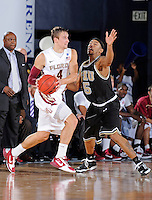 18 November 2010:  FIU's Martavis Kee (5) defends FSU's Deividas Dulkys (4) in the second half as the Florida State University Seminoles defeated the FIU Golden Panthers, 89-66, at the U.S. Century Bank Arena in Miami, Florida.