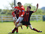 Eoin Hayes of Newmarket Celtic A in action against Darragh Fitzgerald of Bridge United A during their Clare Cup Final at Frank Healy Park. Photograph by John Kelly.
