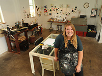 NWA Democrat-Gazette/ANDY SHUPE<br /> Amber Perrodin of Springdale poses Friday, May 26, 2017, in her studio, her favorite place in a historic building she co-owns with her husband.