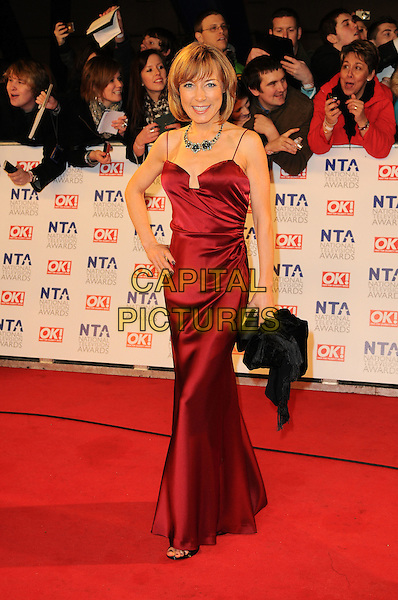 SIAN WILLIAMS.The National Television Awards at O2 Arena, London, England..January 26th, 2011.NTA NTAs full length red dress silk satin maxi hand on hip.CAP/CAS.©Bob Cass/Capital Pictures.