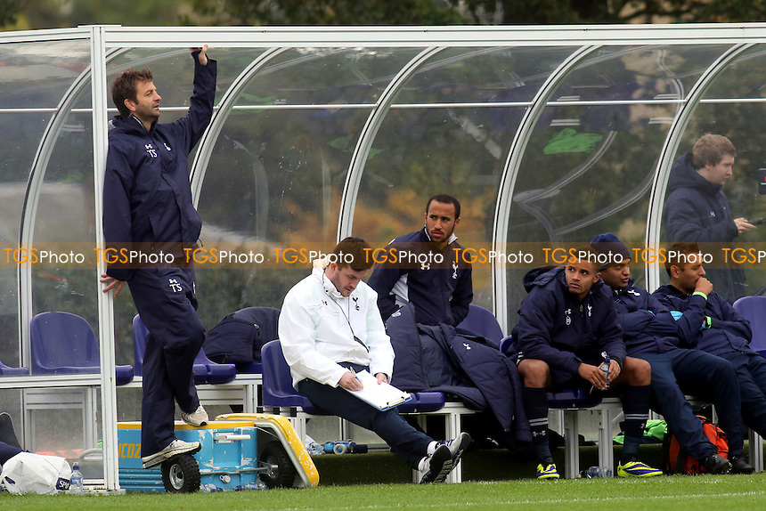 Andros Townsend watches the Under 21 team against Leicester from the Tottenham dugout - Tottenham Hotspur Under-21 vs Leicester City Under-21 - Barclays Under-21 Premier League Football - 21/10/13 - MANDATORY CREDIT: Paul Dennis/TGSPHOTO - Self billing applies where appropriate - 0845 094 6026 - contact@tgsphoto.co.uk - NO UNPAID USE