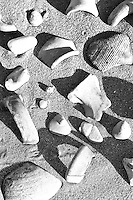 close up of archaeological remains on sand