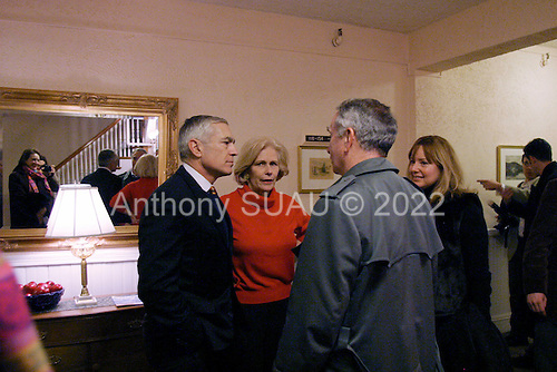 Dixville Notch, New Hampshire.January 26, 2004..General Wesley Clark at the Balsam Hotel where the first votes were cast in the New Hampshire primary at mid-night. Clark receives 8 votes, more than any other democratic candidate...Moments after the voting is announced Clark celebrates with a few friends in private.