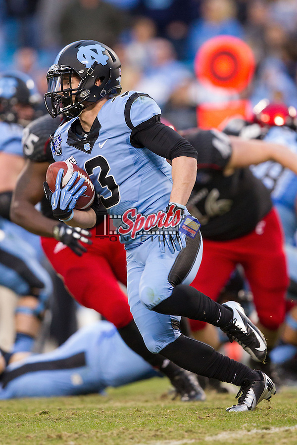 Ryan Switzer (3) of the North Carolina Tar Heels looks for running room against the Cincinnati Bearcats in the Belk Bowl at Bank of America Stadium on December 28, 2013 in Charlotte, North Carolina.  The Tar Heels defeated the Bearcats 39-17.   (Brian Westerholt/Sports On Film)