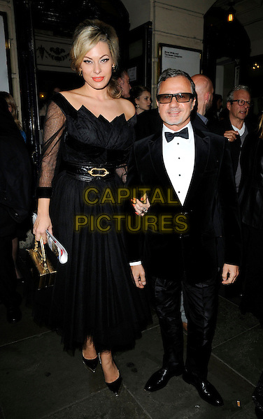 "IMMODESTY BLAIZE & GUEST .Attending the ""Snow White And The Seven Designers"" Gala Performance, Garrick theatre, London, England, UK, October 14th 2010..full length black sheer sleeves dress belt gold waist clutch bag .CAP/CAN.©Can Nguyen/Capital Pictures."
