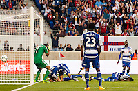 FC Dallas goalkeeper Raul Fernandez (1), Matt Hedges (24) and Erick (12) react to an own goal. The New York Red Bulls defeated FC Dallas 1-0 during a Major League Soccer (MLS) match at Red Bull Arena in Harrison, NJ, on September 22, 2013.