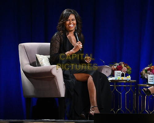 SUNRISE FL - MAY 10: Former First Lady Michelle Obama attends her book tour 'Becoming' at The BB&T Center on May 10, 2019 in Sunrise, Florida, USA., <br /> CAP/MPI04<br /> ©MPI04/Capital Pictures