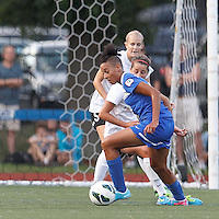 Boston Breakers forward Lianne Sanderson (10) on the attack.  In a National Women's Soccer League (NWSL) match, Boston Breakers (blue) defeated Portland Thorns FC (white/black), 2-1, at Dilboy Stadium on August 7, 2013.