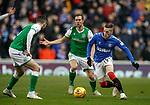 05.02.2020 Rangers v Hibs: Ryan Kent takes on Steven Whittaker and Paul McGinn