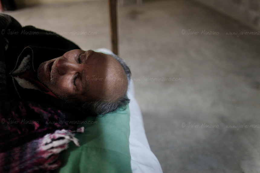 "An elderly man rests peacefully at ""Casa Migrante"", an immigrant shelter in Tecate, Baja California, Mexico on February 7, 2013.  (Javier Manzano / For The Washington Post)."