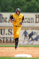 Jacksonville Suns outfielder Matt Juengel (15) runs the bases after hitting a home run during the 20th Annual Rickwood Classic Game against the Birmingham Barons on May 27, 2015 at Rickwood Field in Birmingham, Alabama.  Jacksonville defeated Birmingham by the score of 8-2 at the countries oldest ballpark, Rickwood opened in 1910 and has been most notably the home of the Birmingham Barons of the Southern League and Birmingham Black Barons of the Negro League.  (Mike Janes/Four Seam Images)
