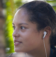 Young Hawaiian Local woman listening to an iPod in Haleiwa, North Shore of Oahu