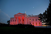 The White House, seen from the North Grounds, is bathed in pink light in honor of Breast Cancer Awareness Month, Thursday, October 14, 2010..Mandatory Credit: Lawrence Jackson - White House via CNP