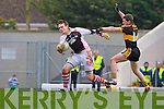Dr Crokes Kieran O'Leary  stops Rathmore's keeper Padraic McCarthy clearing during the O'Donoghue Cup final in Fitzgerald Stadium on Sunday