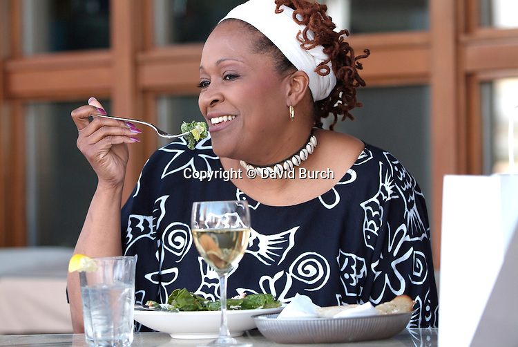 African American woman eating, outside