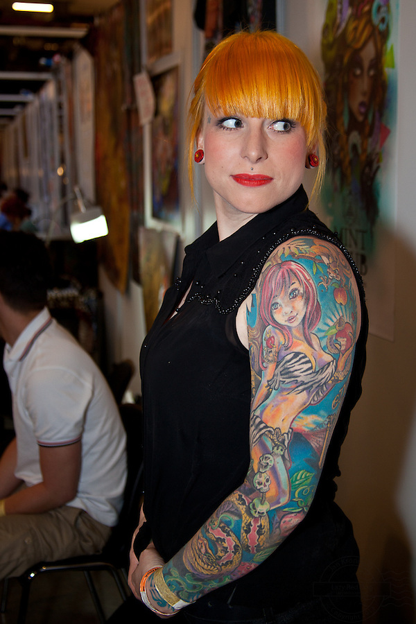 Copenhagen Inkfestival 2012. Biblical cartoon tattoo of Eve with apple and snake