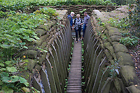 Visitors walk through a World War I trench at Memorial Museum Passchendaele in Zonnebeke, West Flanders, Belgium, August 28, 2014. 2014 marks 100th anniversary of the Great War.