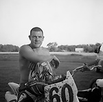 A motocross competitor sits for a portrait after a race in rural, Sussex County, Delaware in June of 2009.