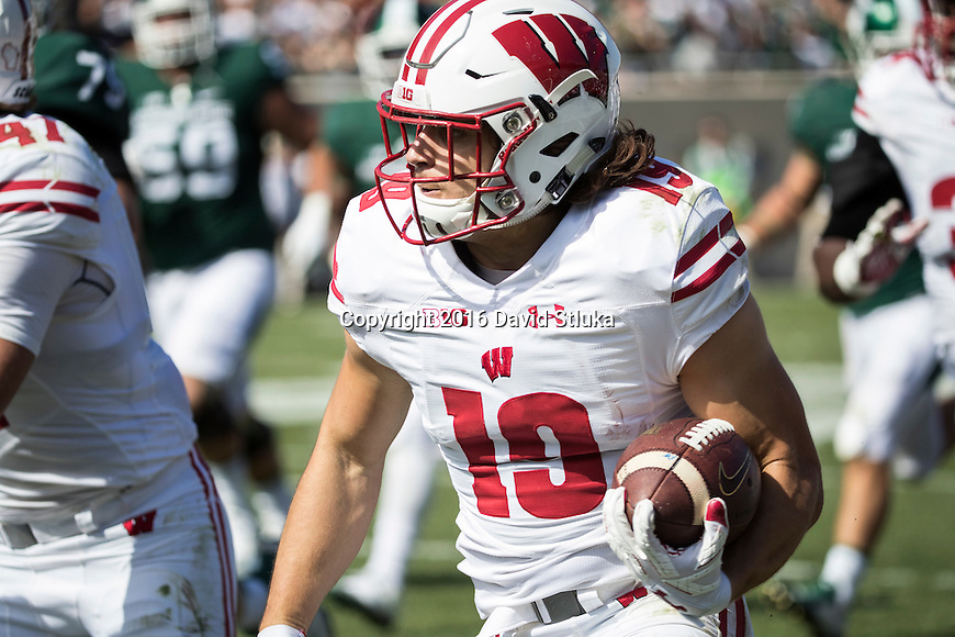 Wisconsin Badgers defensive back Leo Musso (19) returns a fumble for a touchdown during an NCAA college football game against the Michigan State Spartans Saturday, September 24, 2016, in East Lansing, Michigan. The Badgers won 30-6. (Photo by David Stluka)